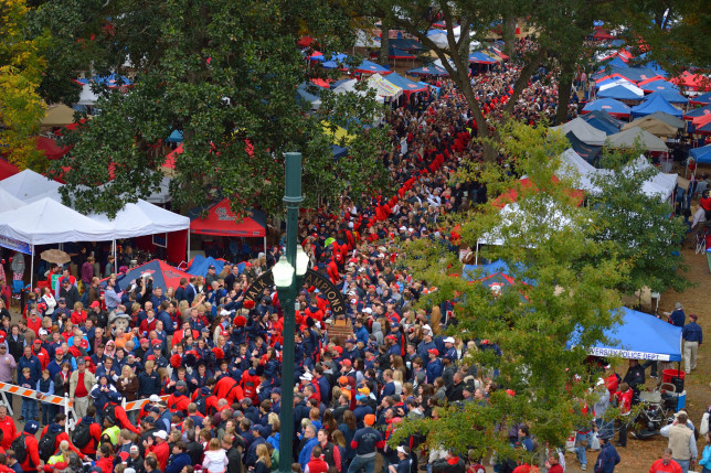 Rebel Football team walks through the Grove before the Arkansas game. Photo by Kevin Bain/Ole Miss Communications